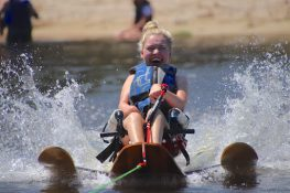 Woman going beyond limits and trying adaptive water skiing