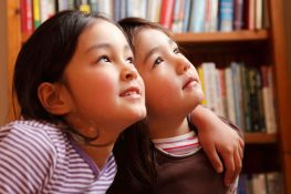 two little girls thinking about their dream