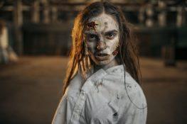 female-zombie-walking-in-abandoned-factory-horror-M393SWP-1170×781